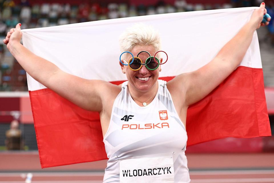 <p>Poland's Anita Wlodarczyk wears Olympic-themed glasses to celebrate winning gold in the Women's Hammer Throw Final at Olympic Stadium on August 3.</p>