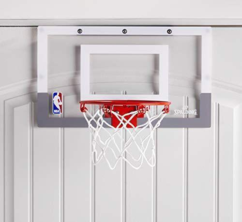 """<p><strong>Spalding</strong></p><p>amazon.com</p><p><strong>$26.66</strong></p><p><a href=""""https://www.amazon.com/dp/B0085AOZIK?tag=syn-yahoo-20&ascsubtag=%5Bartid%7C10055.g.29413969%5Bsrc%7Cyahoo-us"""" rel=""""nofollow noopener"""" target=""""_blank"""" data-ylk=""""slk:Shop Now"""" class=""""link rapid-noclick-resp"""">Shop Now</a></p><p>When the weather outside is bad, your kid can still let off some steam indoors with this over-the-door basketball hoop. It's compact enough to fit perfectly over most doors, and it even <strong>comes with a mini rubber basketball</strong> that you just need to inflate. <em>All ages</em></p>"""