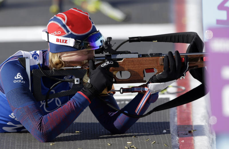 Norway's Tora Berger shoots during a training session at the Biathlon stadium, at the 2014 Winter Olympics, Wednesday, Feb. 5, 2014, in Krasnaya Polyana, Russia. (AP Photo/Lee Jin-man)