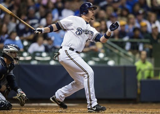 Milwaukee Brewers' Travis Ishikawa hits a three-RBI double off of San Diego Padres' Andrew Werner during the third inning of a baseball game, Wednesday, Oct. 3, 2012, in Milwaukee. Ryan Braun, Jonathan Lucroy and Carlos Gomez scored on the hit. (AP Photo/Tom Lynn)