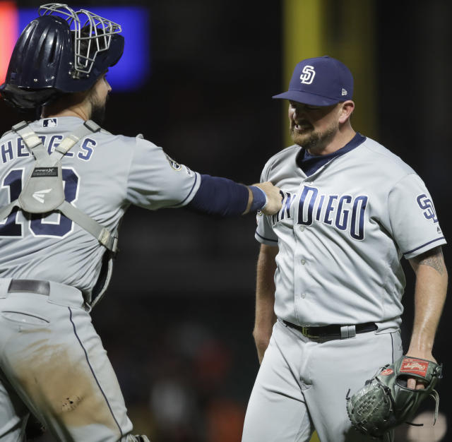 San Diego Padres pitcher Kirby Yates, right, celebrates with Austin Hedges after the team's 4-1 win over the San Francisco Giants in a baseball game Saturday, Aug. 31, 2019, in San Francisco. (AP Photo/Ben Margot)