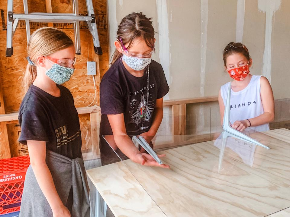 Members of Girl Scout Troop 65430 make PPE. (Photo: Randi Bangertner)