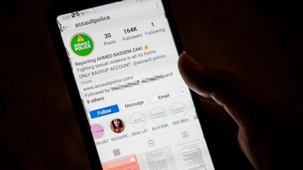 PHOTO: A woman checks on her phone an Instagram account for reporting allegations of sexual harassment and misconduct against Ahmed Bassam Zaki, a 22-year-old student, in Cairo, July 15, 2020.  (Khaled Desouki/AFP via Getty Images)