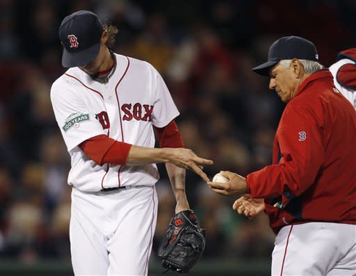 Boston Red Sox starting pitcher Clay Buchholz, left gives the ball to manager Bobby Valentine as he is taken out against the Oakland Athletics during the seventh inning of a baseball game at Fenway Park in Boston, Monday, April 30, 2012. Buchholz allowed six run in the inning, (AP Photo/Charles Krupa)