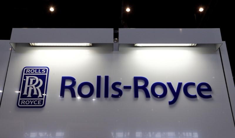 FILE PHOTO: A Rolls-Royce logo is pictured on the company booth during the European Business Aviation Convention & Exhibition (EBACE) at Cointrin airport in Geneva, Switzerland, May 24, 2016. REUTERS/Denis Balibouse/File Photo