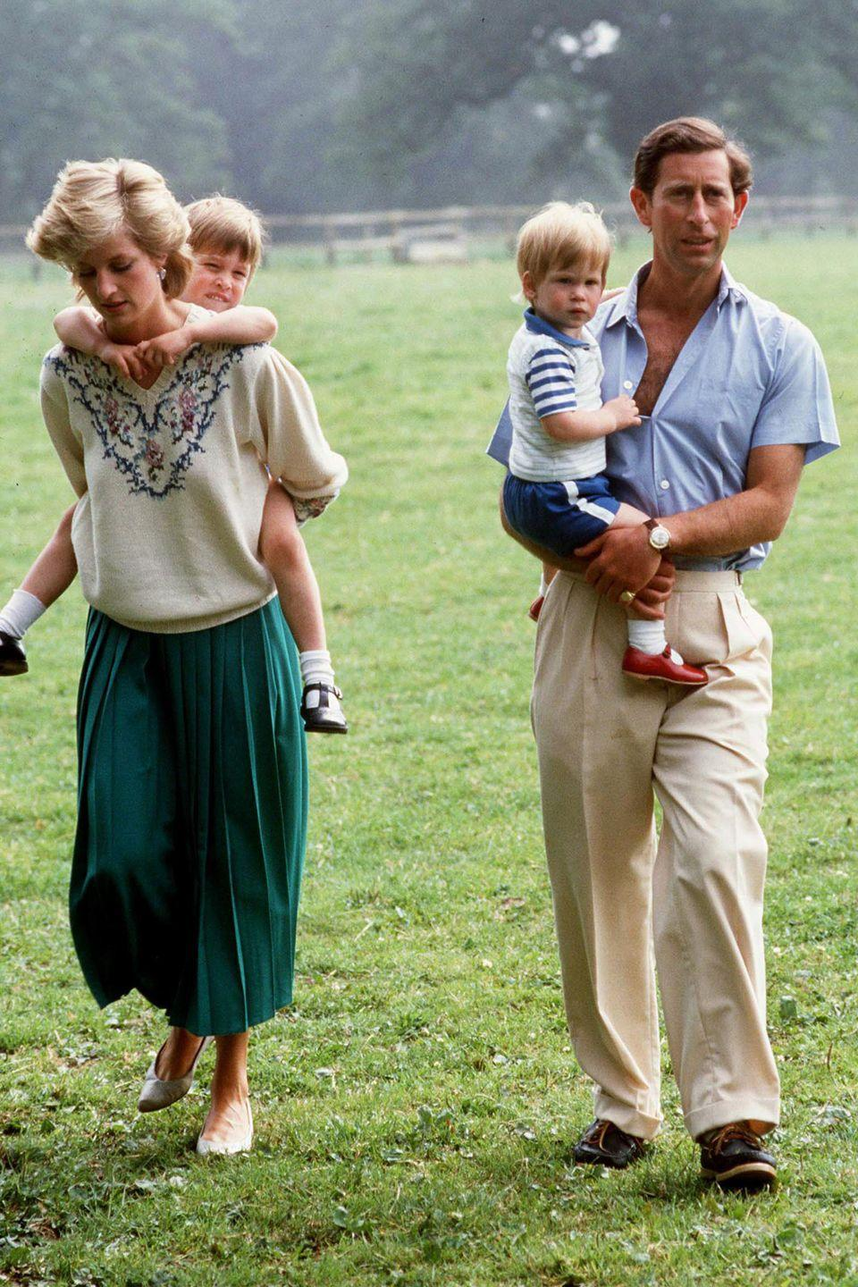 <p>Giving Prince William a piggyback ride while at home with her family in The Gardens Of Highgrove House.</p>