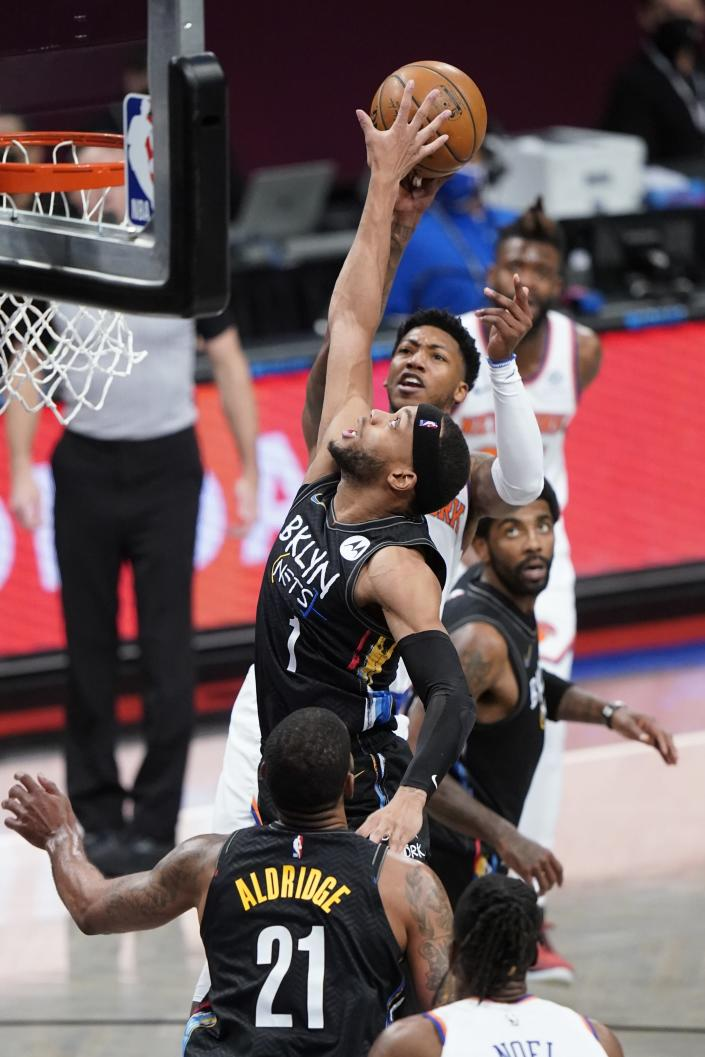 Brooklyn Nets' Bruce Brown (1) blocks a shot by New York Knicks' Elfrid Payton during the second half of an NBA basketball game Monday, April 5, 2021, in New York. (AP Photo/Frank Franklin II)