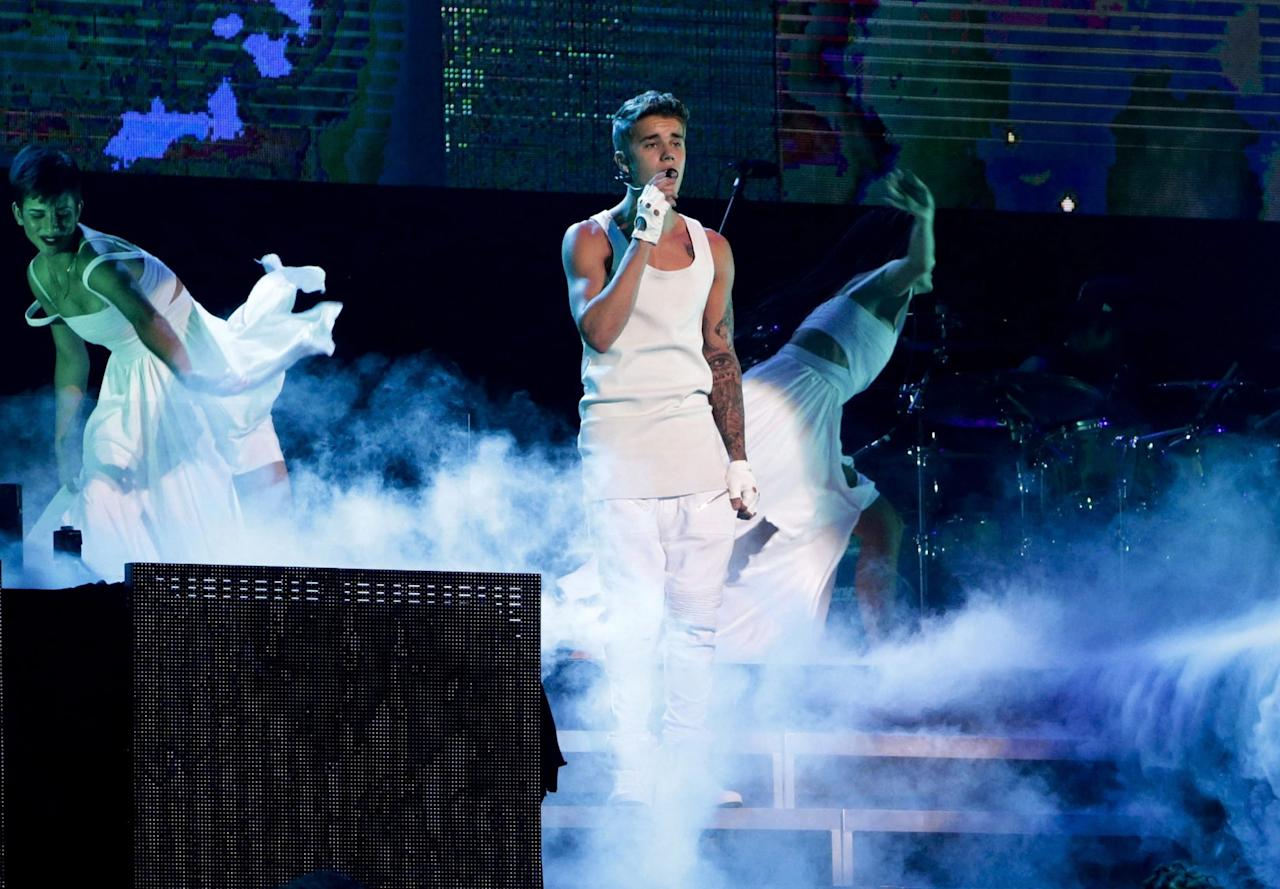 <p><strong>Who pays?</strong><br />Before embarking on a tour, most acts take out non-appearance insurance. This is to protect their income in case of a <em>force majeure</em>, serious accident or illness rendering them unable to perform.<br /><br />(Justin Bieber performs during his world tour in Beijing, China, on Sept. 29, 2013. Canadian Press) </p>