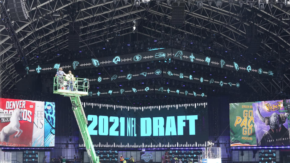 Workers continue preparing the NFL Draft Theatre for the 2021 NFL Draft, Tuesday, April 27, 2021, in Cleveland. After going all virtual in 2020 due to the COVID-19 pandemic, the three-day draft, which has grown into one of America's biggest, non-game sporting events, returns with thousands of fans who will be separated by their loyalties, and whether they've been vaccinated.(AP Photo/Tony Dejak)