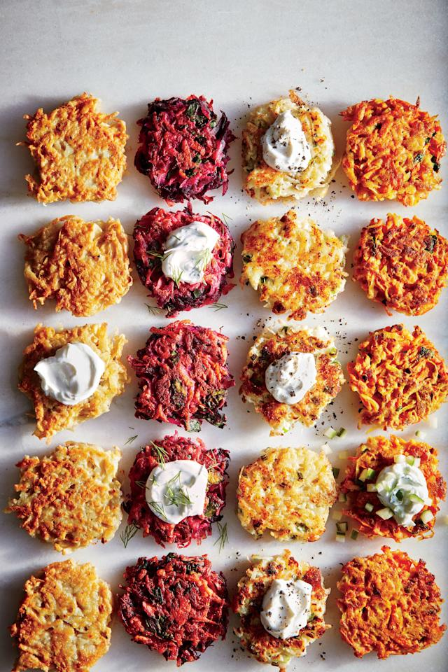 "<p>No Hanukkah celebration is complete without latkes. Go classic potato for the first night, and then try borscht-inspired beet, cheesy cauliflower and Gruyère, and earthy-sweet carrot and curry variations on the other nights. The trick to crispy cakes with less oil is to start with a very dry grated potato mixture: Drain well, and then squeeze in a clean kitchen towel. The frying oil may get too hot during successive batches; remove pan from heat for a minute or two, and lower the temperature as needed.</p> <p><a href=""https://www.myrecipes.com/recipe/potato-latkes-3"">Potato Latkes Recipe</a></p>"