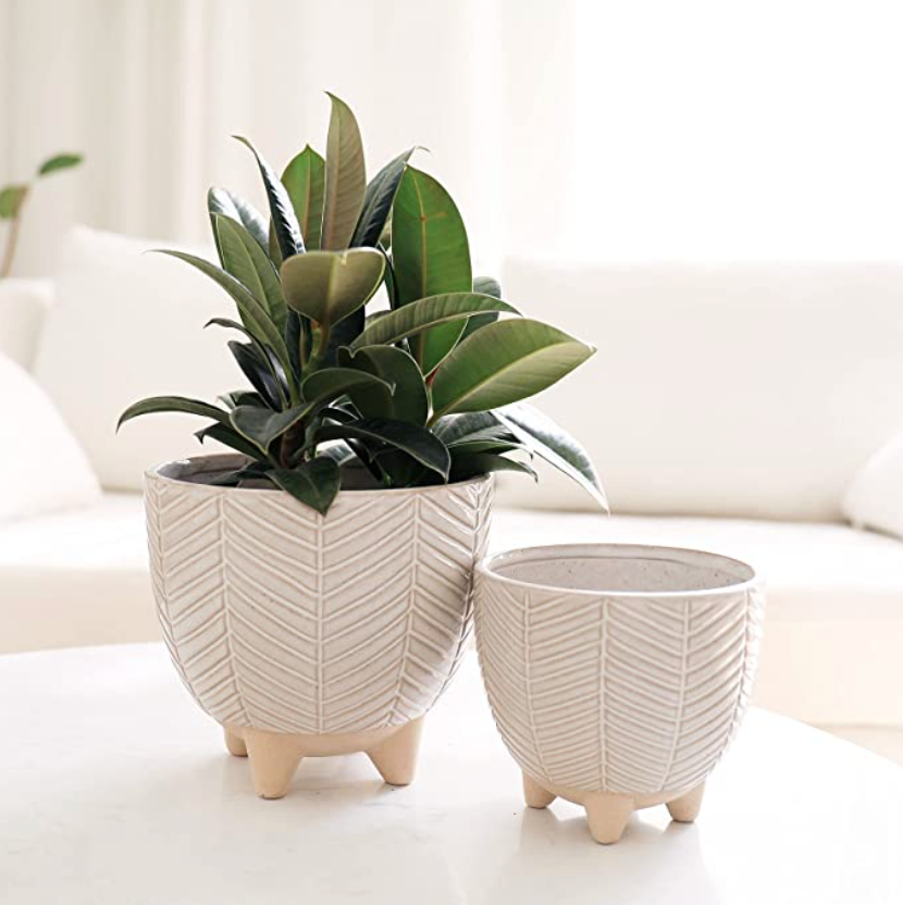 """<h3>Terracotta Planter Pots</h3><br>This set of footed terracotta planters is <em>so</em> magical that, whenever we're not around, they get up and walk around our apartments. <br><br><strong>La Jolie Muse</strong> Ceramic Footed Flower Plant Pots, $, available at <a href=""""https://amzn.to/3me3GQy"""" rel=""""nofollow noopener"""" target=""""_blank"""" data-ylk=""""slk:Amazon"""" class=""""link rapid-noclick-resp"""">Amazon</a>"""