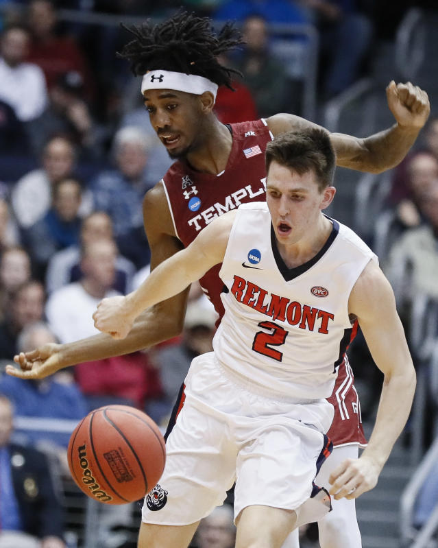 Belmont's Grayson Murphy (2) and Temple's Quinton Rose, left, scramble for the ball during the first half of a First Four game of the NCAA college basketball tournament, Tuesday, March 19, 2019, in Dayton, Ohio. (AP Photo/John Minchillo)