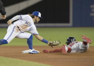 Boston Red Sox's Mookie Betts steals second under the tag of Toronto Blue Jays shortstop Bo Bichette during the seventh inning of a baseball game Thursday, Sept. 12, 2019, in Toronto. (Fred Thornhill/The Canadian Press via AP)
