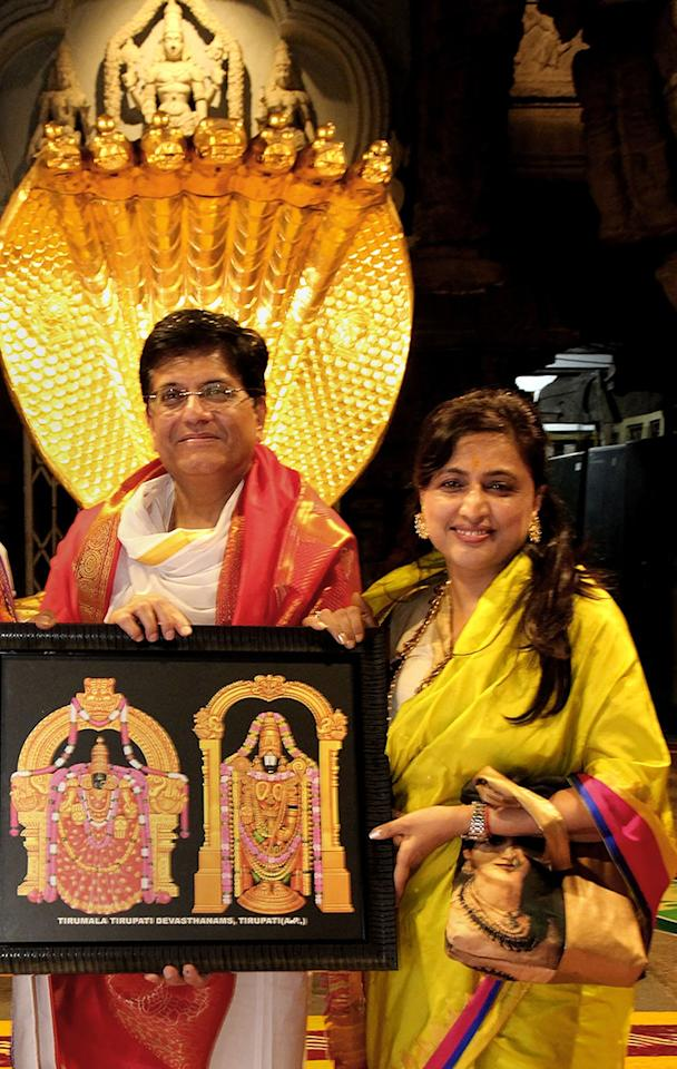 Union Railways and Commerce Minister Piyush Goyal poses with his wife Seema Goyal during his visit at Lord Venkateswara temple in Tirupati, Chittoor. (Image: PTI)