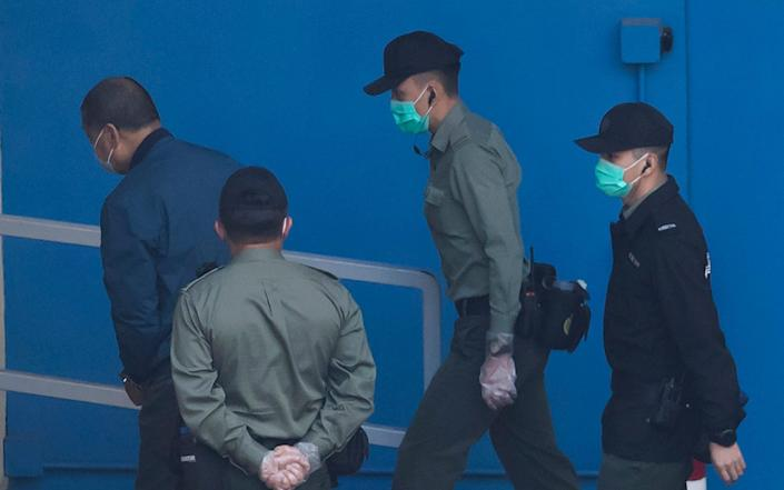 Jimmy Lai is escorted away