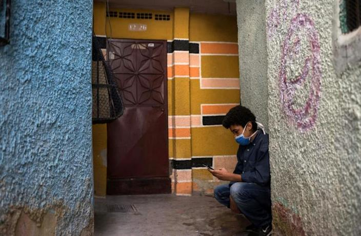 Jonathan Figueroa, 14, looking for a neighbor's wifi signal in Caracas' Bello Campo district, October 2020