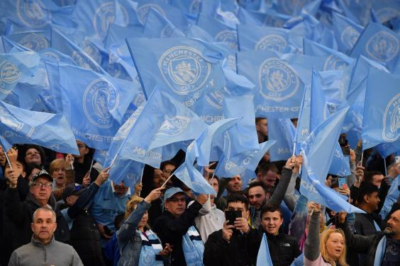 Manchester City fans at a Champions League game (AFP/Getty Images)