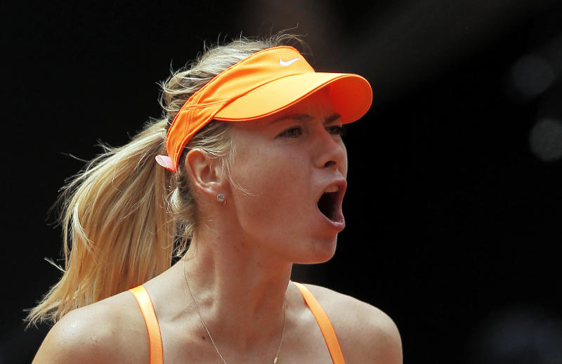 Maria Sharapova from Russia celebrates her victory during the match against Sabine Lisicki from Germany at the Madrid Open tennis tournament, in Madrid, Thursday, May 9, 2013. (AP Photo/Andres Kudacki)