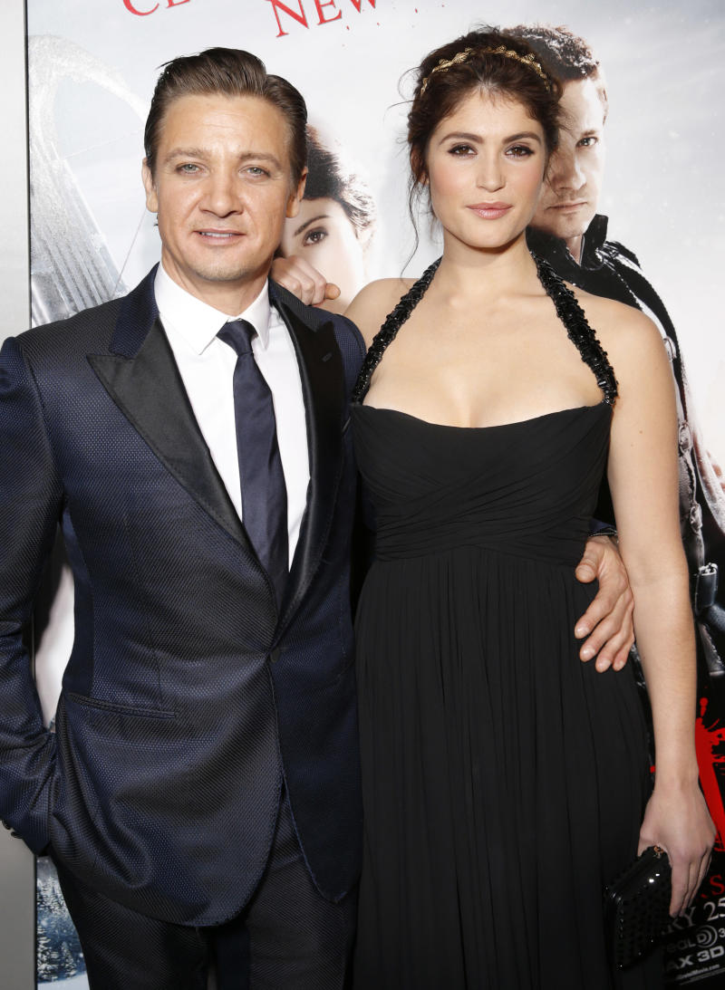 """Jeremy Renner and Gemma Arterton arrive at the premiere of """"Hansel & Gretel Witch Hunters"""" on Thursday Jan. 24, 2013, in Los Angeles.  (Photo by Todd Williamson/Invision/AP)"""