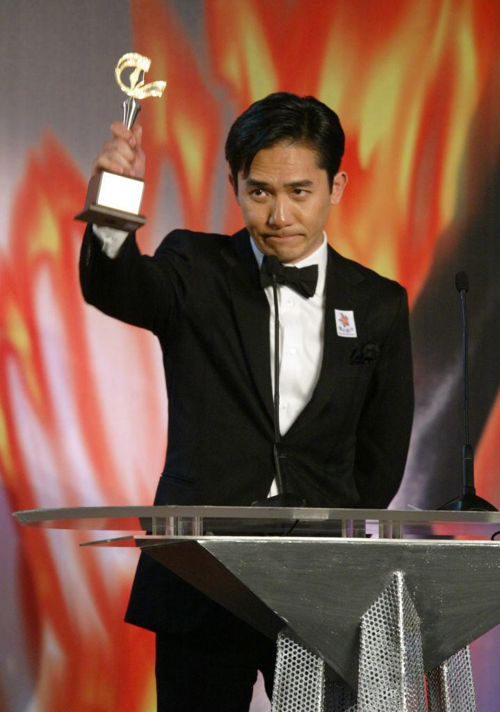 Tony Leung Chiu-wai, winner of the Best Actor on The 10th Golden Bauhinia Film Awards at Hi Tek Trade and Exhibition Center, Kowloon Bay. 06 March 2005 (Photo by DICKSON LEE/South China Morning Post via Getty Images)