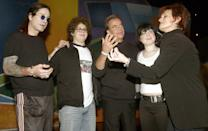 """Sharon Osbournes jokes around with Dick Clark as (L to R) husband Ozzy Osbourne, son Jack and daughter Kelly look on before rehearsing on January 11, 2003 for the upcoming American Music Awards in Los Angeles. The family, who stars in the reality based show """"The Osbournes,"""" will host this years American Music Awards on January 13. REUTERS/Adrees Latif AL"""