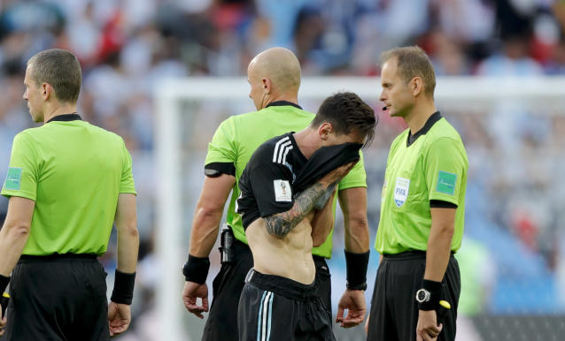 <p>Argentina's Lionel Messi covers his face at the end of the group D match </p>
