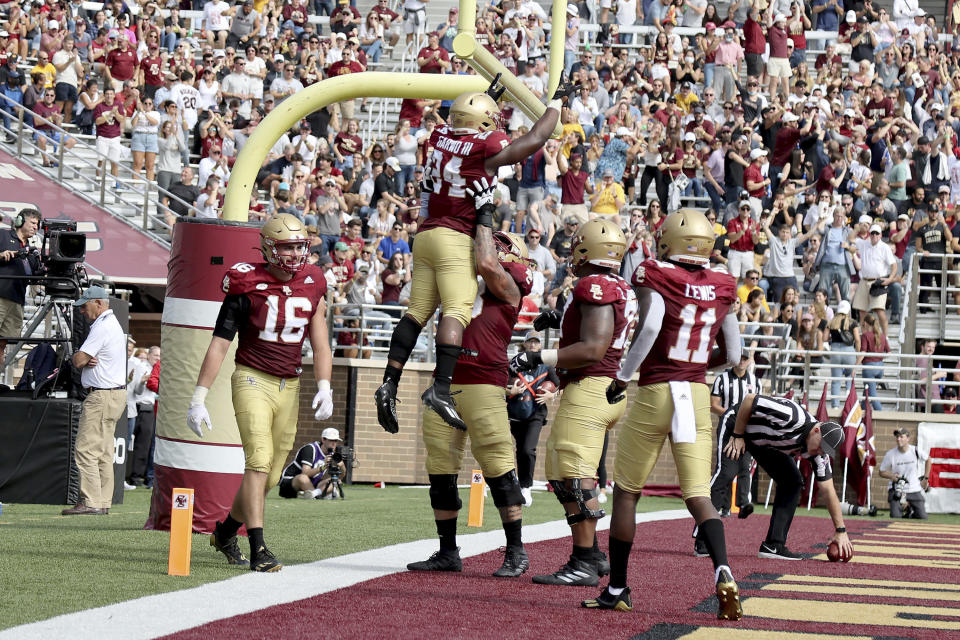 Boston College running back Pat Garwo III (24) is lifted by a teammate after scoring a touchdown during the second half of an NCAA college football game against Missouri, Saturday, Sept. 25, 2021, in Boston. (AP Photo/Mary Schwalm)