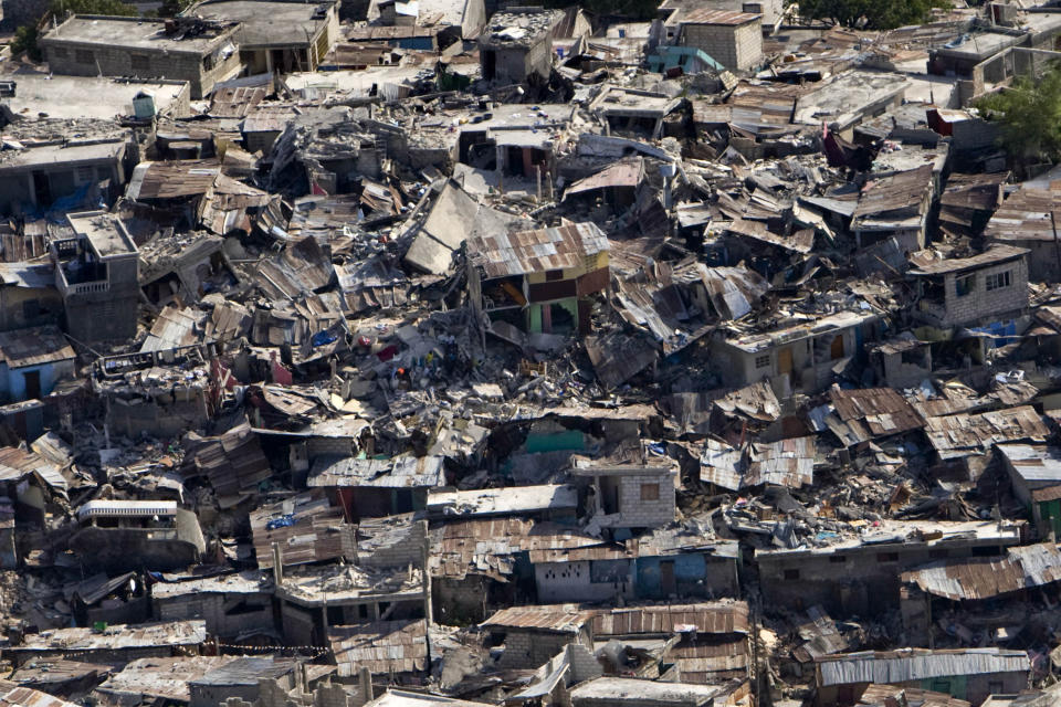 <p>A poor neighbourhood shows the damage after an earthquake measuring 7.0 rocked Port-au-Prince, the Haitian capital just before 5 pm yesterday, on Jan. 13, 2010 in Port-au-Prince, Haiti. (Photo: Logan Abassi/MINUSTAH via Getty Images) </p>