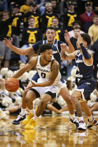 Missouri's Torrence Watson, bottom, looks to pass around Charleston Southern's Deontaye Buskey, right, and Duncan LeXander, top, during the first half of an NCAA college basketball game Tuesday, Dec. 3, 2019, in Columbia, Mo. (AP Photo/L.G. Patterson)
