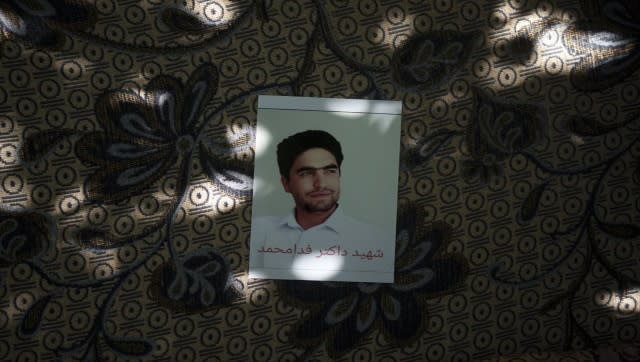A portrait of Fida Mohammad, a 24-year-old dentist, who died after falling from a departing U.S. Air Force C-17 on Aug. 16, hangs in his family house in Kabul, Afghanistan, Friday, 17 September 17, 2021. AFP