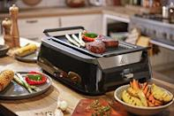 """<p><strong>Philips Kitchen</strong></p><p>amazon.com</p><p><strong>$149.99</strong></p><p><a href=""""https://www.amazon.com/dp/B075MZR2JV?tag=syn-yahoo-20&ascsubtag=%5Bartid%7C2140.g.19924022%5Bsrc%7Cyahoo-us"""" rel=""""nofollow noopener"""" target=""""_blank"""" data-ylk=""""slk:Shop Now"""" class=""""link rapid-noclick-resp"""">Shop Now</a></p><p>Anyone else have a dad who wished grilling season was all year long (so much so that he was willing to stand outside in the snow to cook steaks)? This indoor, smokeless grill will give your parents those perfect grill marks without the chance of catching a cold.</p>"""