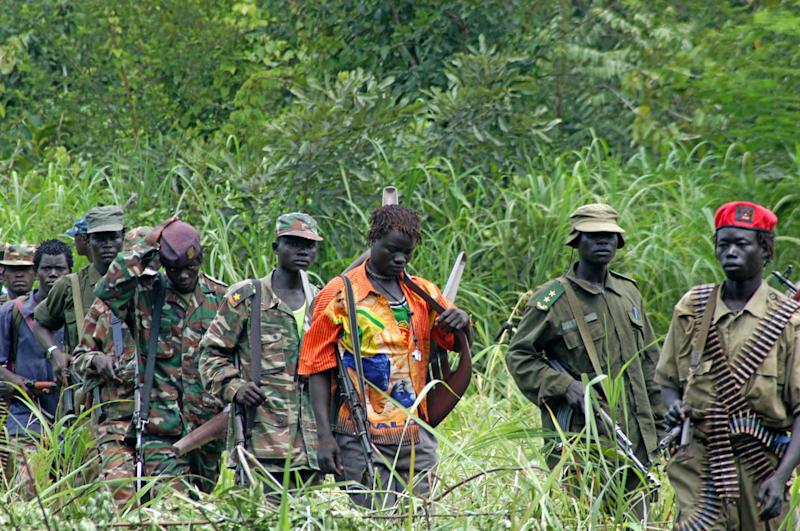 FILE - In this July 31, 2006 file photo, members of Uganda's Lord's Resistance Army are seen as their leader Joseph Kony meets with a delegation of Ugandan officials and lawmakers and representatives from non-governmental organizations, in the Democratic Republic of Congo near the Sudanese border. The number of soldiers in the violent Ugandan rebel group Lord's Resistance Army has dwindled to the low hundreds, and without external support could soon cease to exist, Uganda's military spokesman said Tuesday, Nov. 2, 2010 echoing the findings of a new report. (AP Photo/File)