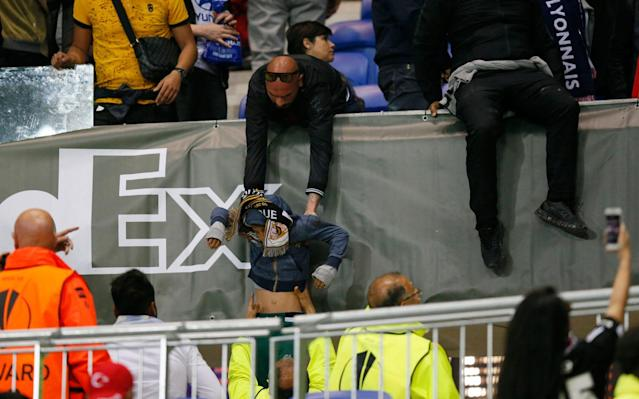 Supporters try to escape the violenceCredit: REUTERS