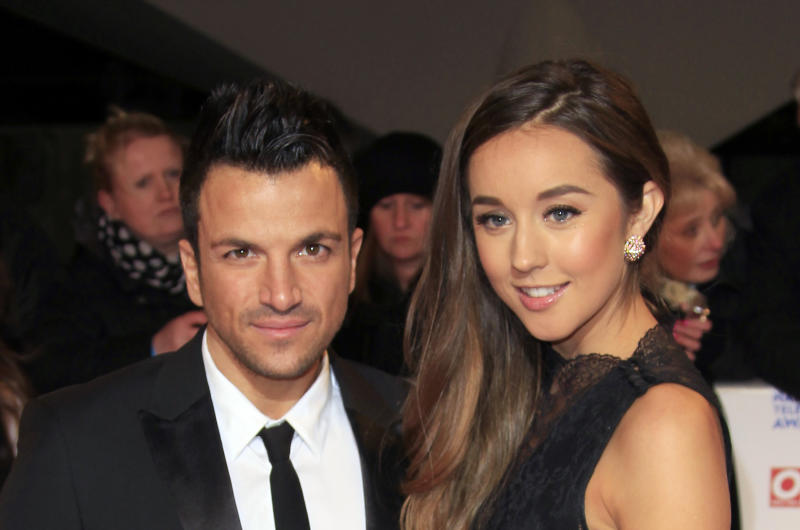Peter Andre, left, and Emily Macdonagh seen at the National Television Awards at the o2 Arena on Wednesday, Jan. 23, 2013, in London. (Photo by Joel Ryan/Invision/AP)
