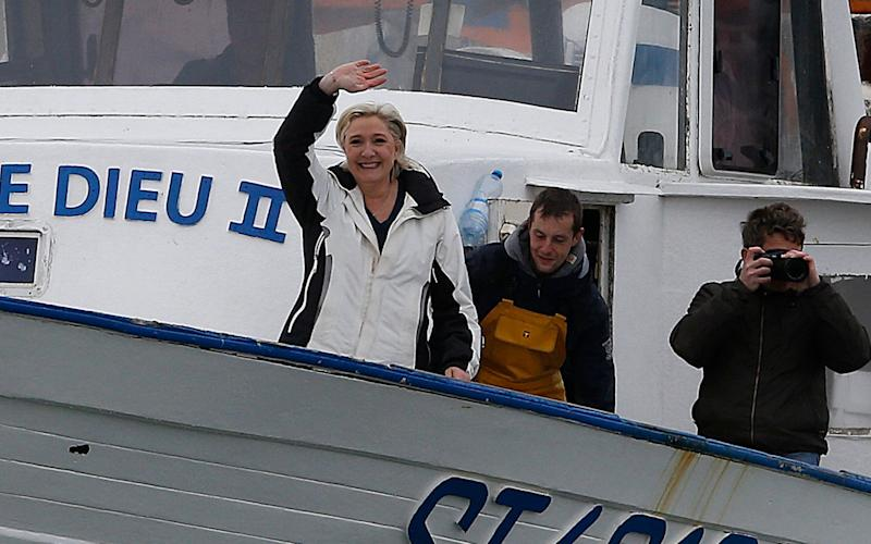 French presidential candidate Marine Le Pen waves upon her arrival on a fishing boat at the port of Grau du Roi, Southern France - EPA