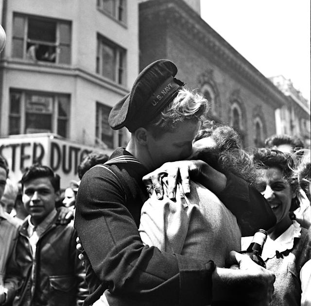 """A kiss in Times Square displays the mood of the world on V-E Day (or """"Victory in Europe"""" Day), signalling the end of hostilities in the European theatre in World War II, on May 8, 1945, in New York, New York. (Photo by Michael Ochs Archives/Getty Images)"""