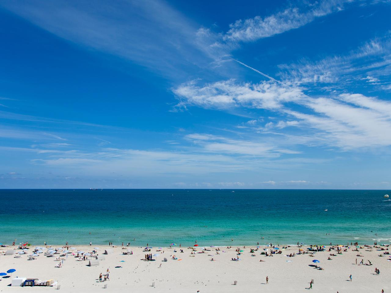 """<p>Beautiful people, flashy cars, skimpy bathing suits, Art Deco architecture: It's all here on the 2.2-mile white sand stretch that makes up Florida's most famous beach. The busiest—and most touristy—section runs parallel to Ocean Drive (between 5th and 15th Streets), so locals tend to hang around the quieter patches south of Fifth Street. Hotel beach clubs dominate the shoreline from 15th Street to 22nd Street, but rest assured, there's still plenty of space for anyone to throw down a towel.</p> <p><strong>Who it's best for:</strong> Those who enjoy a busy beach scene with plenty of eye candy</p> <p><strong>The vibe:</strong> Endless summer</p> <p><strong>Where to stay:</strong> Your best bet for a quality hotel in the heart of South Beach lies on 15th Street, at elegant beachfront boutique property, <a href=""""https://www.cntraveler.com/hotels/united-states/miami-beach/betsy-hotel?mbid=synd_yahoo_rss"""" target=""""_blank"""">The Betsy South Beach</a>.</p>"""