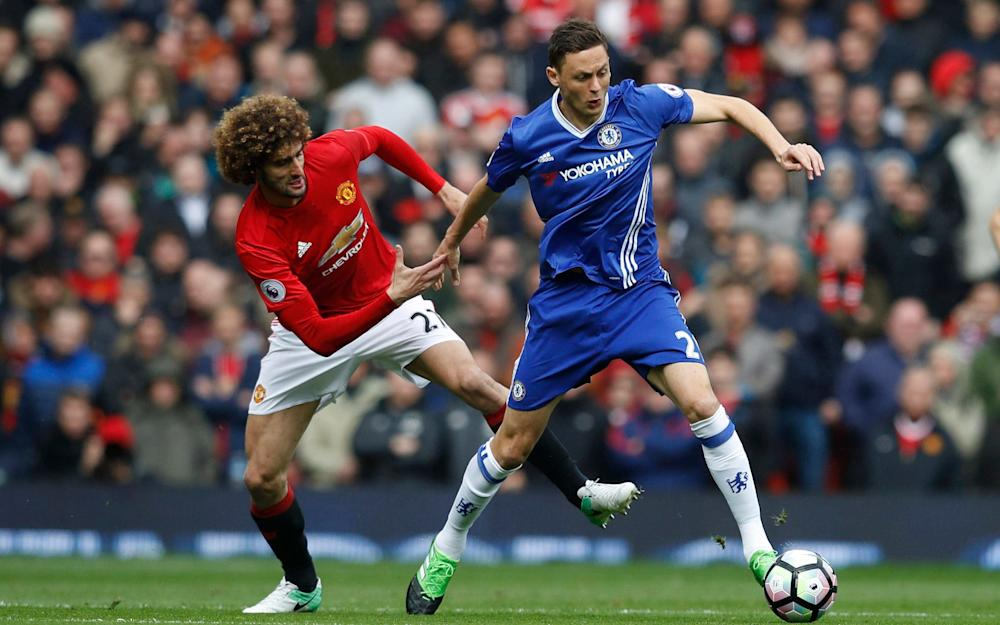 Manchester United's Marouane Fellaini in action with Chelsea's Nemanja Matic - Credit: REUTERS