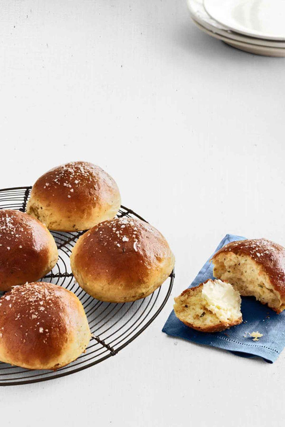 """<p>The fresh herbs are what make these rich, buttery brioche rolls taste so good. </p><p><em><strong><a href=""""https://www.womansday.com/food-recipes/food-drinks/recipes/a39889/rosemary-brioche-rolls-recipe-clx0414/"""" rel=""""nofollow noopener"""" target=""""_blank"""" data-ylk=""""slk:Get the Rosemary Brioche Rolls recipe"""" class=""""link rapid-noclick-resp"""">Get the Rosemary Brioche Rolls recipe</a>.</strong></em></p>"""