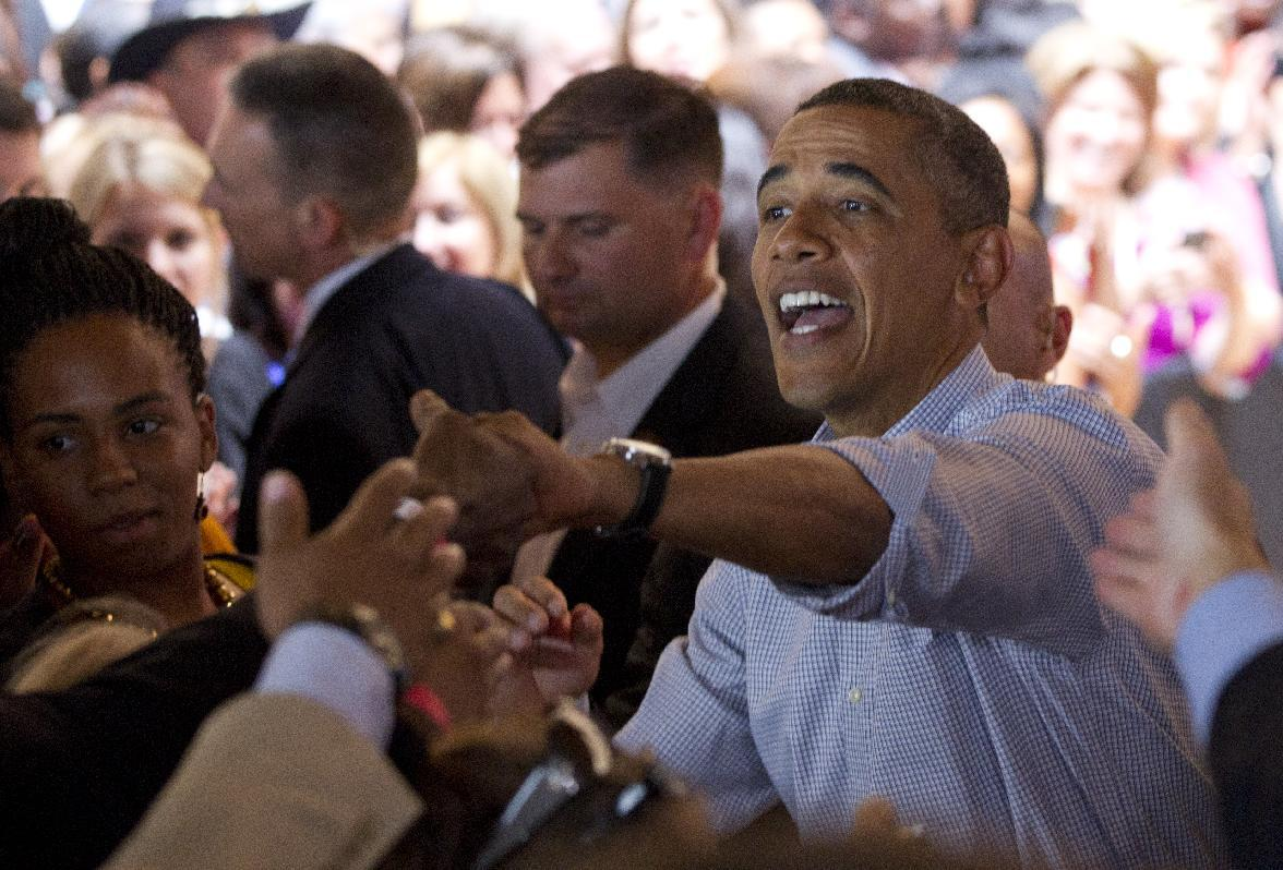 President Barack Obama, right, shakes hands after speaking during a campaign event at Bridgeport Art Center, Sunday, Aug. 12, 2012, in Chicago. (AP Photo/Carolyn Kaster)