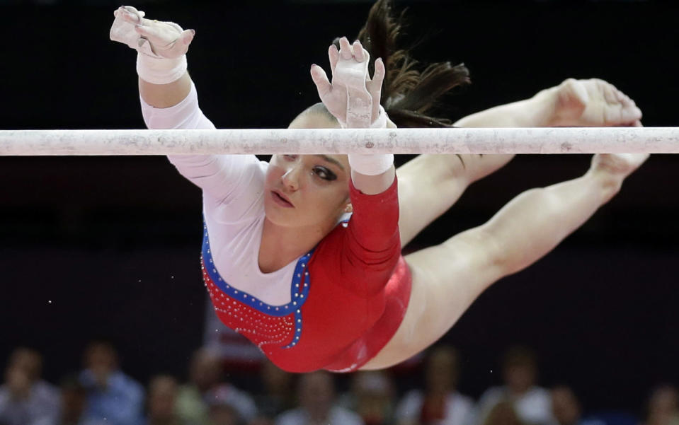 Russian gymnast Aliya Mustafina performs on the uneven bars during the artistic gymnastics women's apparatus finals at the 2012 Summer Olympics, Monday, Aug. 6, 2012, in London. (AP Photo/Julie Jacobson)