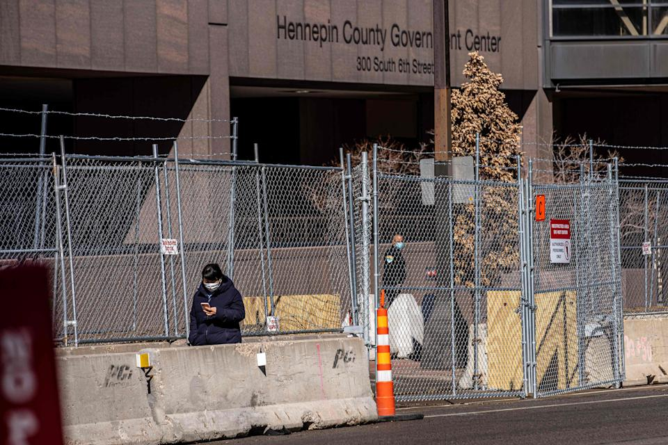 Layers of barbed wire fence cover the front of Hennepin County Government Headquarters in Minneapolis. Security measures were increased for the trial of former Minneapolis police officer Derek Chauvin in George Floyd's death.