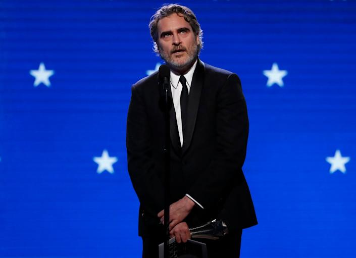Joaquin Phoenix accepts the award for Best Actor at the Critics' Choice Awards: REUTERS