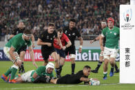 New Zealand's Aaron Smith scores a try during the Rugby World Cup quarterfinal match at Tokyo Stadium between New Zealand and Ireland in Tokyo, Japan, Saturday, Oct. 19, 2019. (AP Photo/Mark Baker)