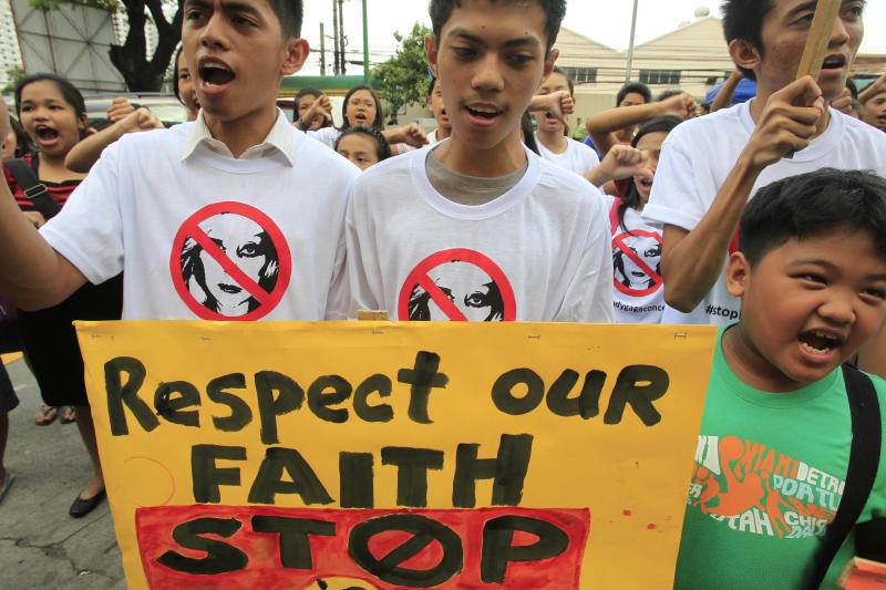 """Filipino Christian youths chant """"Stop the Lady Gaga concerts"""" during a rally, calling for the cancellation of the singer's May 21-22 concerts, outside the Pasay City Hall in Pasay, south of Manila, Philippines, Friday, May 18, 2012. The youths said they are offended by Lady Gaga's music and videos, in particular her song """"Judas"""" which they say mocks Jesus Christ. Lady Gaga's concert was marked also by protest from evangelical groups in South Korea and the singer scrapped an Indonesia concert following protests from conservative Muslims. (AP Photo/Bullit Marquez)"""