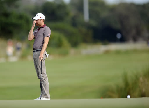 Chris Kirk reacts after missing a birdie putt on the 13th green during the final round of the McGladrey Classic golf tournament on Sunday, Nov. 10, 2013, in St. Simons Island, Ga. (AP Photo/Stephen Morton)