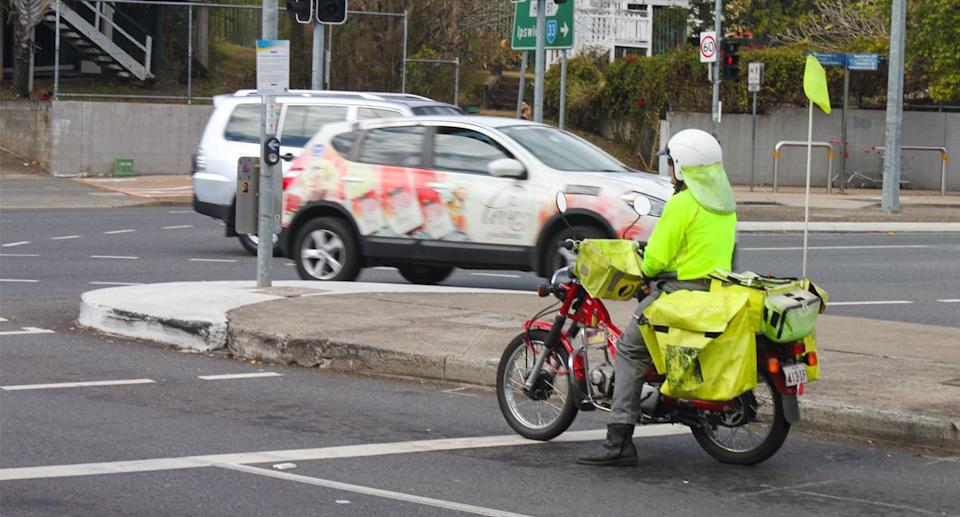 Australia Post plans to recognise the postie's efforts with the package on the Coal Coast in New South Wales.