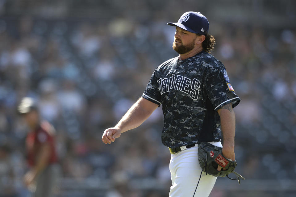 San Diego Padres' Kirby Yates reacts on his way to the dugout after recording the last out of the top of the ninth inning of a baseball game against the Arizona Diamondbacks Sunday, Aug. 19, 2018, in San Diego. (AP Photo/Orlando Ramirez)