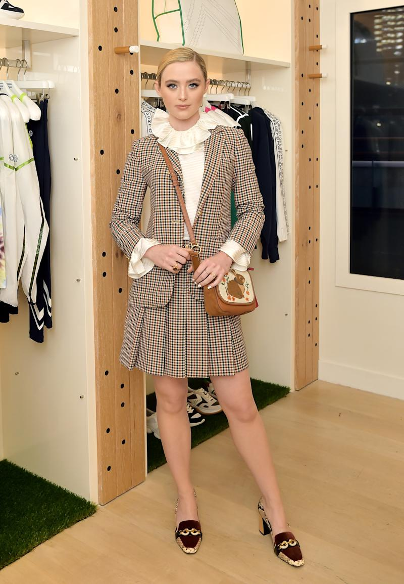 KATHRYN Kathryn Newton wearing the Plaid Blazer and Mini Skirt, Satin Stripe Ruffle Blouse, Jessa Velvet Pump, Perry Needlepoint Bunny Flap Cross-Body, Sawyer Twist Round Watch, and Reva Oversized Round Sunglasses.