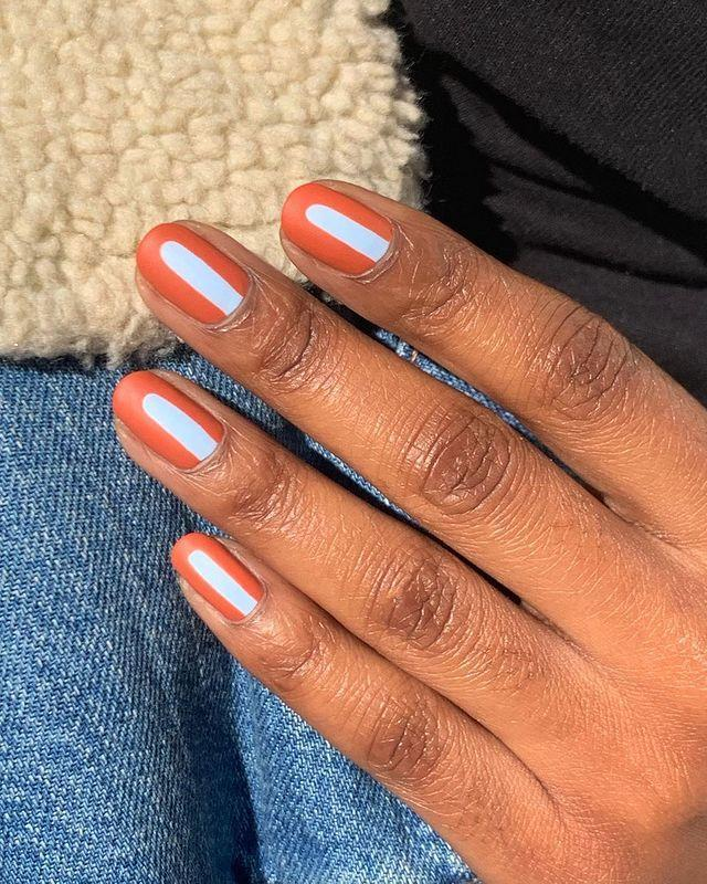 "<p>Don't have nail tape? Just use nail polish instead. Start with a coat or two of <a href=""https://www.cosmopolitan.com/style-beauty/beauty/g22690432/best-matte-nail-polish-colors-brands/"" rel=""nofollow noopener"" target=""_blank"" data-ylk=""slk:matte nail polish"" class=""link rapid-noclick-resp"">matte nail polish</a>, and once it's dry, use a different polish in a complementary color to paint a line down the center. To add a little more interest, stop the line just before the tips and round it off, just like your nail shape.</p><p><a href=""https://www.instagram.com/p/B8m8uzSJaZb/?utm_source=ig_embed&utm_campaign=loading"" rel=""nofollow noopener"" target=""_blank"" data-ylk=""slk:See the original post on Instagram"" class=""link rapid-noclick-resp"">See the original post on Instagram</a></p>"